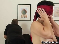 Old grandmother in stockings takes two cocks