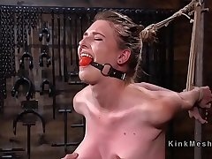 Hogtied slave with spreaded legs caned